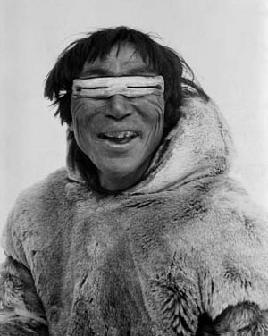 Inuit wearing traditional slit sunglasses design